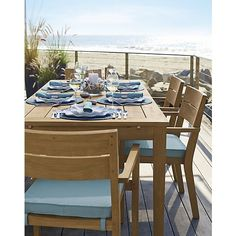 Our eco-friendly Regatta teak dining collection cuts a clean, classic profile in a bold wide-slat design, handcrafted with mortise-and-tenon joinery and finished with galvanized steel hardware. Each piece is solid teak certified by the Forest Stewardship Council (FSC), a nonprofit organization that encourages responsible management of the world's forests. We recommend allowing the unfinished teak to weather to a silvery grey. To maintain the natural color, use our Golden Care® Teak…