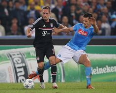 Christian Maggio (R) of SSC Napoli competes for the ball with Franck Ribery of FC Bayern Muenchen during the UEFA Champions League Group A match between SSC Napoli and FC Bayern Muenchen at Stadio San Paolo on October 18, 2011 in Naples, Italy.