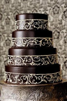 Love the white on chocolate and stunning scrollwork.