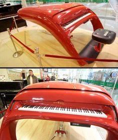 Ferrari Piano.  Schimmel Pegasus Guoqin piano was inspired by Ferrari sport cars.