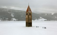Lake Reschen is an artifical reservoir which submerged several villages and a 14th century church.