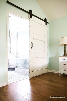 this is actually what i want  3 panel DIY barn door - The Handmade Home