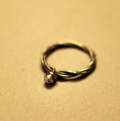 Guitar string ring http://www.etsy.com/listing/108192841/guitar-string-ring-engagement-style