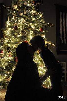take a picture every year with your kids in front of the tree, silhouette style