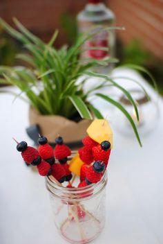 Place various berries on skewers as a drink garnish for summer  #Smirnoff #vodka