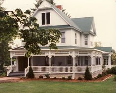 love this wrap around porch and all the white millwork