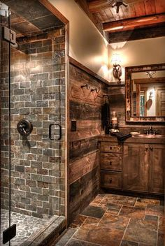 Rustic Bathroom using sliced Red Pebble tile in shower pan.  https://www.pebbletileshop.com/products/Sliced-Red-Pebble-Tile.html#.VZrsXflViko