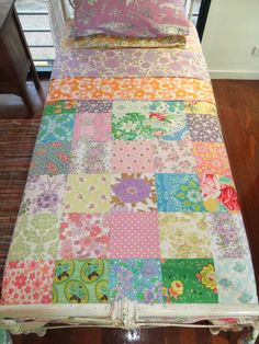 Patchwork quilt--looks vintage but it looks like modern prints were used which would be a great quilt to make from your scraps