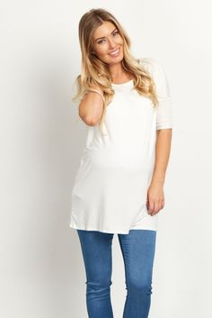 This solid maternity top will keep you comfortable all day and night with a soft bamboo material. Not only does it give you the ultimate comfort, but it can be easily dressed up or down for any occasion. Style this top with maternity jeans and your favorite boots for a complete ensemble.