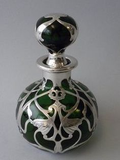 An Antique American Green Glass Sterling Silver Overlay Perfume Bottle of an Art Nouveau Design. made by gorham mfg., providence, rhode island, circa from nelson and nelson antiques Antique Perfume Bottles, Vintage Perfume Bottles, Design Art Nouveau, Perfumes Vintage, Jugendstil Design, Glas Art, Bottle Art, Glass Bottles, American Green