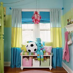 Storage is key in a kids' room. It makes it easier on the kids and the parents if everything has a place of its own. A window seat bench with a shelf for locker bins helps organize and store toys with ease.