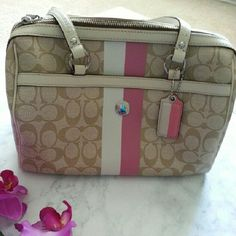 """Coach Pink and Cream Sachel Handbag Authentic Coach handbag. Like new condition, used only a couple of times. Perfect condition inside, outside has  a tiny spot which is shown in the picture provided.    12"""" long 7  & 1/2 """" deep 6 & 1/2 """" wide Coach Bags"""