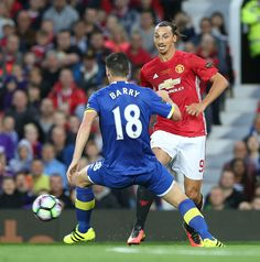Zlatan Ibrahimovic of Manchester United in action with Gareth Barry of Everton during the Wayne Rooney Testimonial match between…