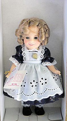 This is Ideal's 1982 8 inch Shirley Temple doll in mint-in-the-box condition dressed in a costume from the movie, The Littlest Rebel. She is $45.00 at my Tias .com site at http://www.donnaskorner.com
