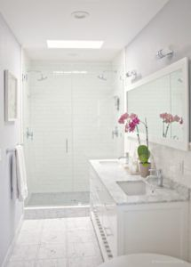 Benjamin Moore Sidewalk Gray in a bathroom with walk in shower, marble floor tile, countertop and white subway tile. Via Relocated Living