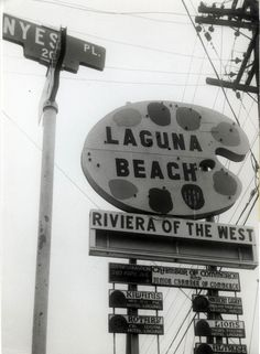 """Sign depicting artist's palette reads, """"Laguna Beach, Riviera of the West"""". Smaller signs below for various Laguna Beach community organizations. Photograph dated June, Orange County California, California Dreamin', Labuan, Community Organizing, Strange Photos, Tide Pools, Beach Signs, Train Tracks, Vintage Signs"""