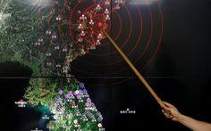 Ryoo Yong-gyu, Earthquake and Volcano Monitoring Division Director, points at…