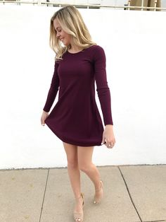 Red holiday dress, nude heels, blonde hair with lowlights.