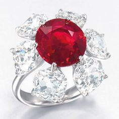 Auction record per carat paid for a ruby. A superb 6.04ct pigeon's blood Burma, no heat cushion-shaped ruby and diamond ring, by Etcetera. © Christie's Images Limited 2012.