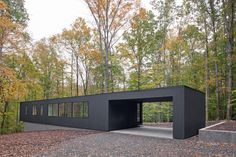 The Corbett Residence is on a wooded site, down a winding drive. The drive is thin and meanders between trees to protect the house from view. The house is a low black box that strikes a line across the slope, mimicking the horizon. The house is at the Container Buildings, Container Architecture, Container House Plans, Container House Design, Container Pool, Shelters In The Woods, Shed Homes, Shipping Container Homes, Shipping Containers