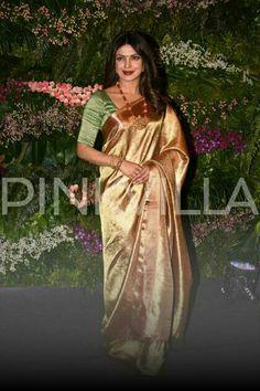 PHOTOS: Priyanka Chopra looks stunning in a golden saree at Anushka Sharma-Virat Kohli's Mumbai reception http://www.pinkvilla.com/entertainment/photos/photos-priyanka-chopra-looks-stunning-golden-saree-anushka-sharma-virat-kohlis-mumbai-reception-394392