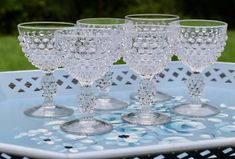 Pretty wine glasses in the ever favorite hobnail design. Listing is for 6 glasses Wine Glasses are made in the USA by Duncan Miller The Hobnail clear pattern was produced between WIne Glasses stand 4 inches tall Glasses are in excellent condition
