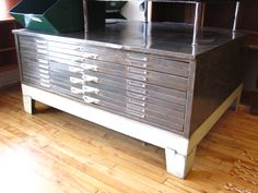 industrial steel flat-file. 10 shallow drawers, sits on a steel base.