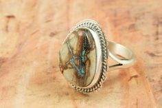 Native American Jewelry  Genuine Boulder Turquoise set in Sterling Silver Ring. Created by Navajo Artist Larson Lee. http://www.treasuresofthesouthwest.com/turquoise-rings.html