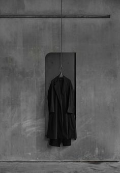 hanging clothes. raw interior, concrete walls and floor.Hangzhou, China Store China by An Design Studio | Yellowtrace