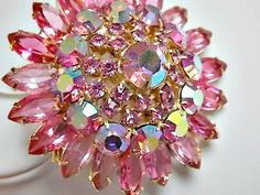 Big, bold & PINK! Sparkling pink dome brooch. Beautiful crystals sparkle & catch the light. Stones are clear and well set in the bright and clean