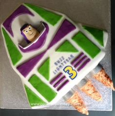 Homemade Buzz Lightyear Spaceship Cake: My son Casper is obsessed with Toy Story and loves Buzz Lightyear. He really wanted a Buzz cake so we compromised and went for Buzz's rocket with Buzz