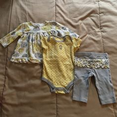 Infant bundle First picture- Grey and yellow long sleeve flower top, grey and yellow flower onesie, and grey ruffle bottoms (6 months). Second picture- CARTERS blue and white POKA dot dress and light green dress with cardigan (3 months). Third picture- Gerber onesie strawberry outfit (0-3 months), Carters blue top with white bottoms (3 months), and Carters pink and blue Onesie with matching bottoms (3 months). Other