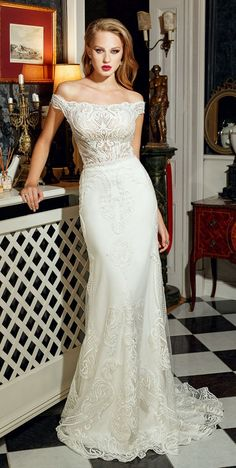 Wedding dress with mermaid silhouette Long train, off-the-shoulders décolletage wedding dress #wedding #weddingdress #weddinggown