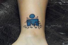 Ironman tattoo -- blue with sports. Love this one.