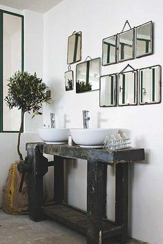 love the sink and vintage mirror collection in this bathroom!