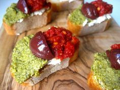 Stacey's Christmas Crostini:    Basil pesto (you can use store bought)  Sundried tomato pesto (recipe to follow)  Goat cheese  Kalamata olives, sliced into quarters  1 baguette, sliced
