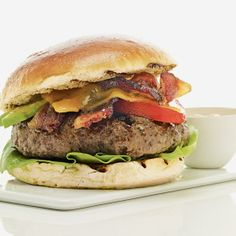 Bacon, avocado and Russian dressing upgrade this burger to new heights.