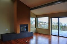 Choice Construction, Remodel, Custom Homes, Gig Harbor, Living Room, Fireplace, Vaulted Ceiling, Wood Floors, Deck