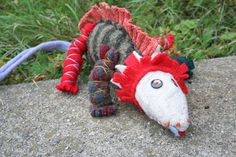 Crispina ffrench's Dino Ragamuffin doll hand sewn from recycled wool sweaters and stuffed with natural raw mohair