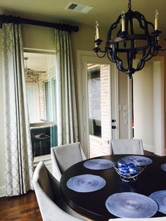 """Geometric patterned drapes with a more formal fabric really completes the look of this breakfast nook. We used 3"""" Wood hardware for a statement.   Design by Traditions Window Decor Dallas"""