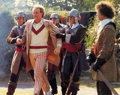 The Fifth Doctor, under armed guard in The Awakening!