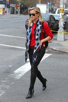 Reese Witherspoon peeled back some winter layers in New York City and paired a silk skinny scarf with a red sweater. The addition of the delicate printed scarf gave her a feminine feel to her otherwise urban look. A similar style has been seen on other celebrities such as Florence Welch and Harry Styles. -Amber R.