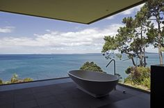 Other spend hours in the bath looking at themselves, I'd spend it looking out to this. Cliff House. Auckland, New   Zealand.