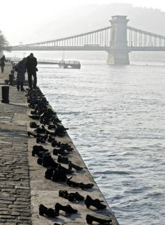 Shoes on the Danube | Alive On All Channels January 27th, hundreds of metal shoes are placed on the banks of the River Danube in Hungary to mark the slaughter of hundreds of Jewish people who were ordered to place their shoes on the bank before being shot and pushed in the river by Hungarian militamen. A terrible and poignant reminder of the atrocities committed in WW2. Destination: the World