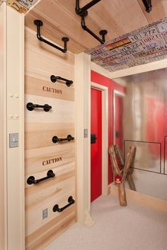 Put heavy duty bars (handicap rails?) going up the wall and ceiling in the basement playroom for climbing | interesting idea