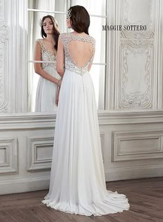 Minuet chiffon sheath wedding dress, balanced perfectly with Swarovski crystals decorating the bust and shoulders. Finished with keyhole back. Joy by Maggie Sottero.