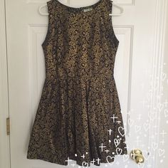 A dress with a vintage look ✨ A cute baby doll dress for any occasion. The pattern in the dress is beautiful. The colors are gold and really dark navy blue. Only worn it twice. ✨ Dresses Mini