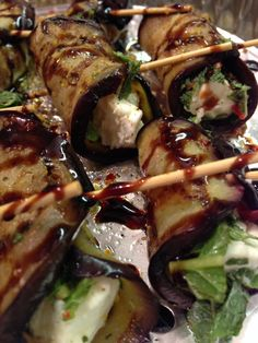 BBQ Aubergine stuffed with feta and fresh mint, drizzled with a balsamic glaze
