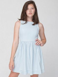 A cool and comfortable denim sun dress featuring a classic A-line shape with a fitted top, flared bottom and back button closure.