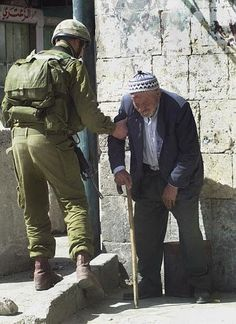 Israeli soldier helps an old arab man. Love conquers all.